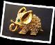 Das Logo für Fotografieren ist ein Produktbild eines goldigen Elefanten